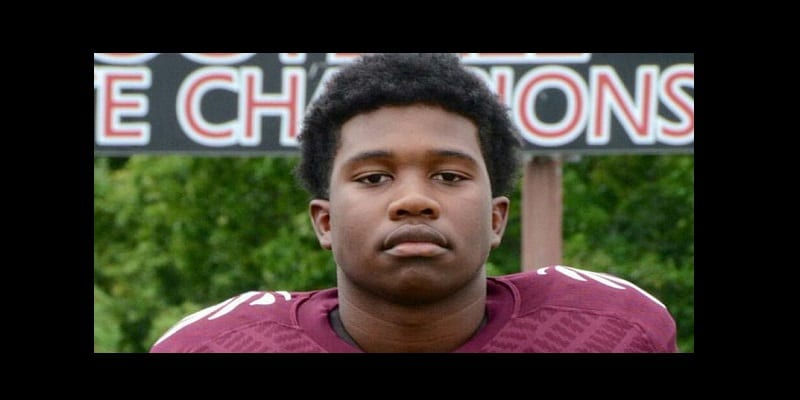 "This undated photo released by the Knox County Schools, high school football player Zaevion Dobson, 15, was shot to death Thursday night, Dec. 17, 2015, in Knoxville, Tenn., as he shielded three girls from gunfire in a shooting spree. Dobson, a sophomore at Fulton High School in northern Knoxville, was ""a fine, fine young man,"" said Fulton High School football coach Rob Black. (Knox County Schools via AP)"