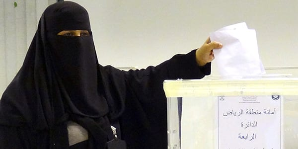 A Saudi woman casts her ballot in an election centre in the Saudi capital of Riyadh, on December 12, 2015. Saudi women were allowed to vote in elections for the first time ever, in a tentative step towards easing widespread sex discrimination in the ultra-conservative Islamic kingdom. AFP PHOTO / DINA FOUAD