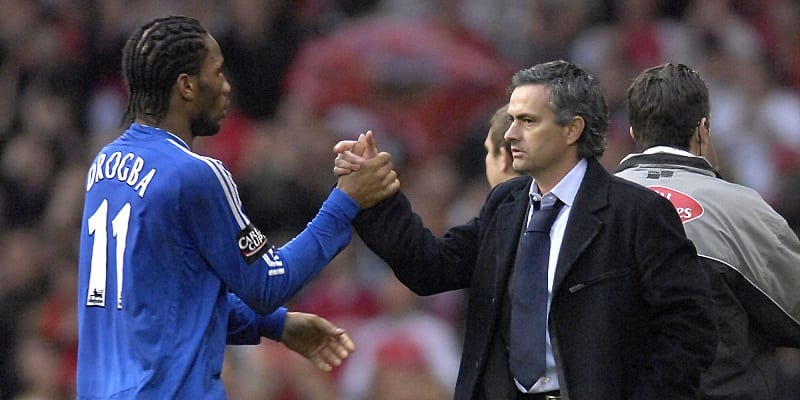 File photo dated 25/02/2007 of Chelsea manager Jose Mourinho (right) and Didier Drogba. PRESS ASSOCIATION Photo. Issue date: Thursday December 12, 2013. Jose Mourinho wants Didier Drogba, who scored the decisive penalty in Chelsea's 2012 Champions League triumph, to experience a hero's return to Stamford Bridge in the knockout stages. See PA story SOCCER Chelsea. Photo credit should read: Rebecca Naden/PA Wire
