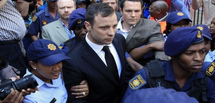 283340-oscar-pistorius-escorted-70