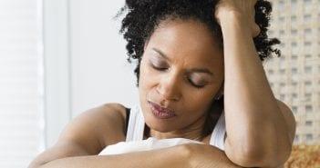 o-SAD-BLACK-WOMAN-ON-BED-facebook