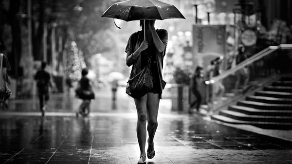 woman-umbrella-rain-street