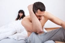 Young couple in quarrel at home. Sitting in the bed
