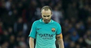 Barcelona's Andres Iniesta looks dejected