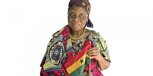 Theodosia-Salome-Okoh-with-flag-730×365