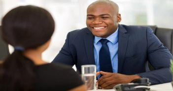 successful african american insurance broker meeting client in o