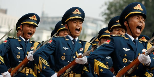 Marching honour guards shout as Chairman of U.S. Joint Chiefs of Staff Joseph Dunford is welcomed during a ceremony in Beijing