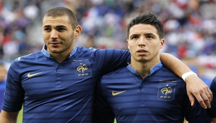 428611-france-s-soccer-team-players-benzema-and-nasri-stand-before-a-friendly-soccer-match-against-serbia-i