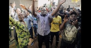 Supporters of Maurice Kamto of Renaissance Movement (MRC) react after his news conference at his headquarter in Yaounde,