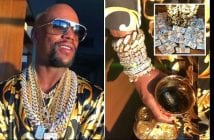 Floyd-Mayweather-flaunts-wealth-by-standing-in-pile-of-money