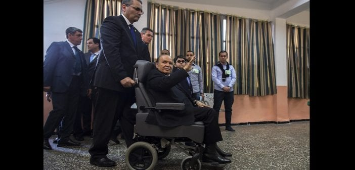 Algeria's President Abdelaziz Bouteflika arrives to cast his ballot during the presidential election in Algiers