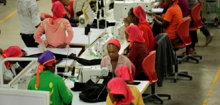 Workers sew clothes inside the Indochine Apparel PLC textile factory in Hawassa Industrial Park in Southern Nations, Nationalities and Peoples region