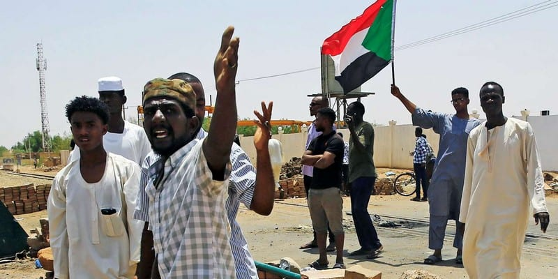 Sudanese protesters set up a barricade on a street, demanding that the country's Transitional Military Council hand over power to civilians, in Khartoum
