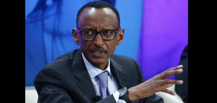 Rwanda President Kagame gestures during the session 'Ending Poverty through Parity' in the Swiss mountain resort of Davos
