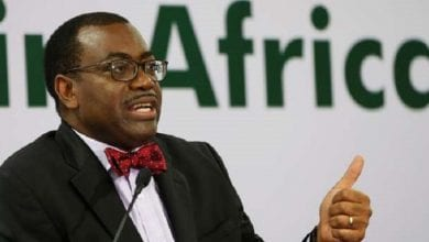 AfDB President Adesina gestures as he addresses a news conference on the first day of the annual meeting of AfDB in Gandhinagar
