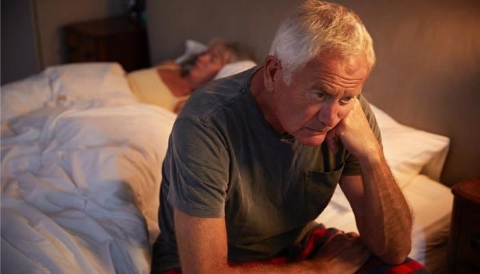 worried-senior-man-in-bed-at-night-suffering-with-insomnia-picture-id864363472-1533380096