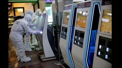 South Korean clean self check-in machines after spraying disinfectant at the international airport amid the rise in confirmed cases of coronavirus disease (COVID-19) in Daegu