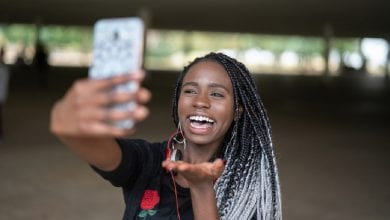 Afro young woman taking selfie photos