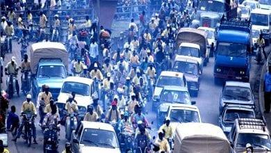 Cotonou, Benin: Heavy traffic beside the Dantopka market of Cotonou. Dantopka is the largest market in west africa. –
