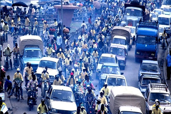 Cotonou, Benin: Heavy traffic beside the Dantopka market of Cotonou. Dantopka is the largest market in west africa. –