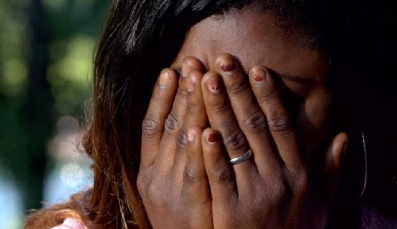 Desperate sad african young woman crying- close up- outdoor