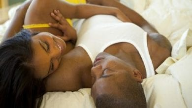 happy-couple-lying-in-bed-together-high-res-stock-photography-88512810-1533853051